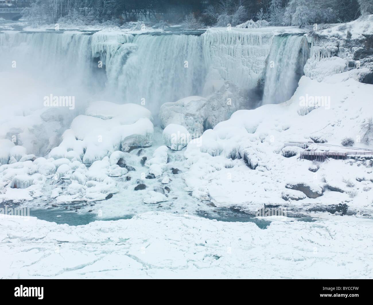 Niagara Falls American waterfall wintertime scenic. As seen from Canadian side. - Stock Image