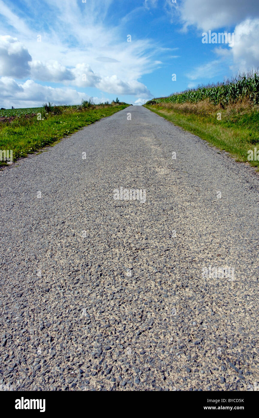 Empty straight country road, UK - Stock Image