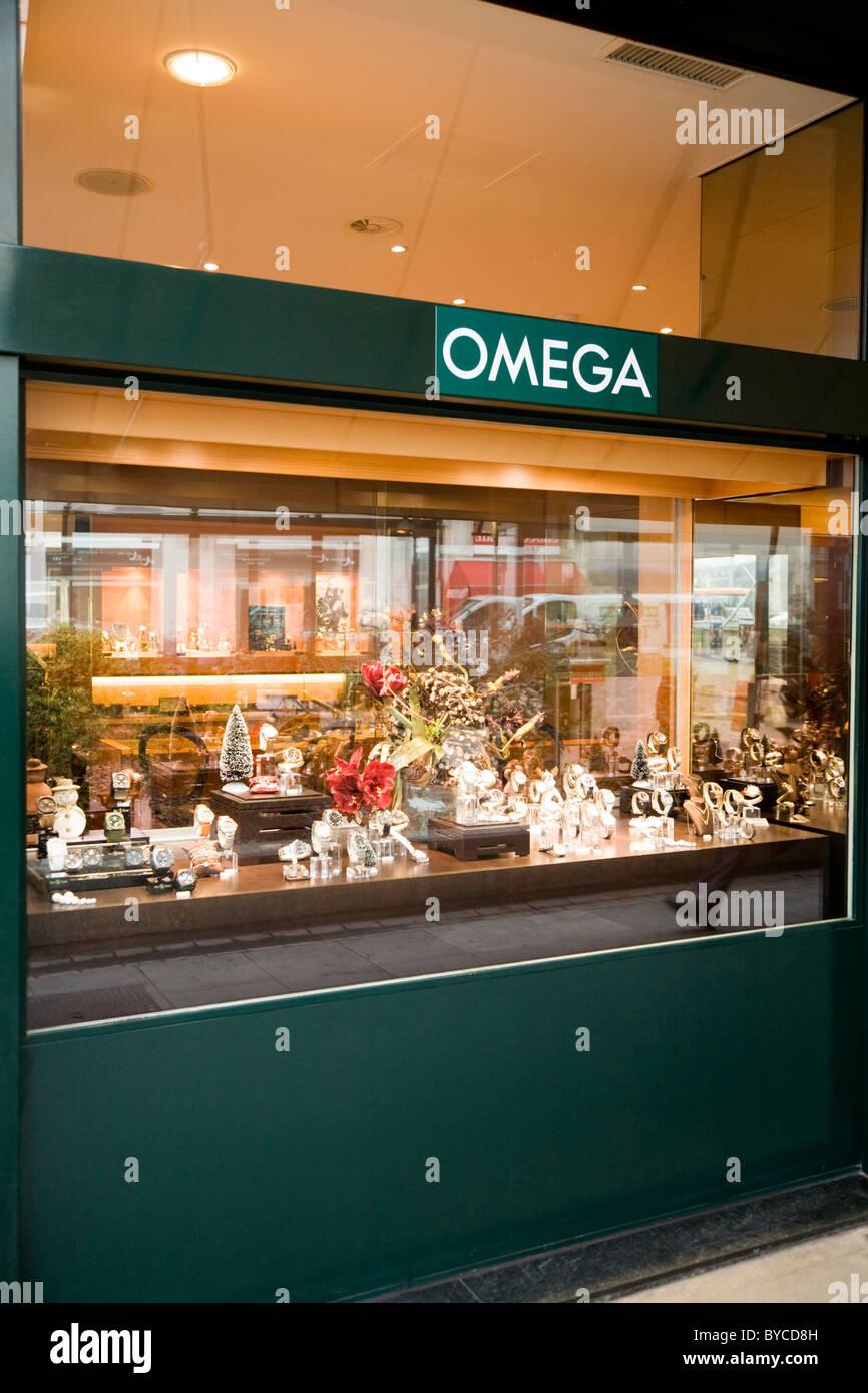 Jeweller / jewellers shop / store in Geneva selling Swiss made Omega wrist watches. Geneve. Switzerland. - Stock Image