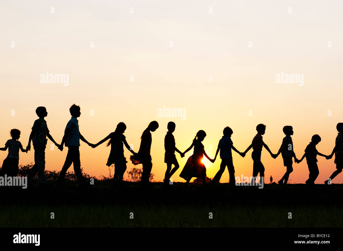 boy and girl holding hands silhouette stock photos boy and girl
