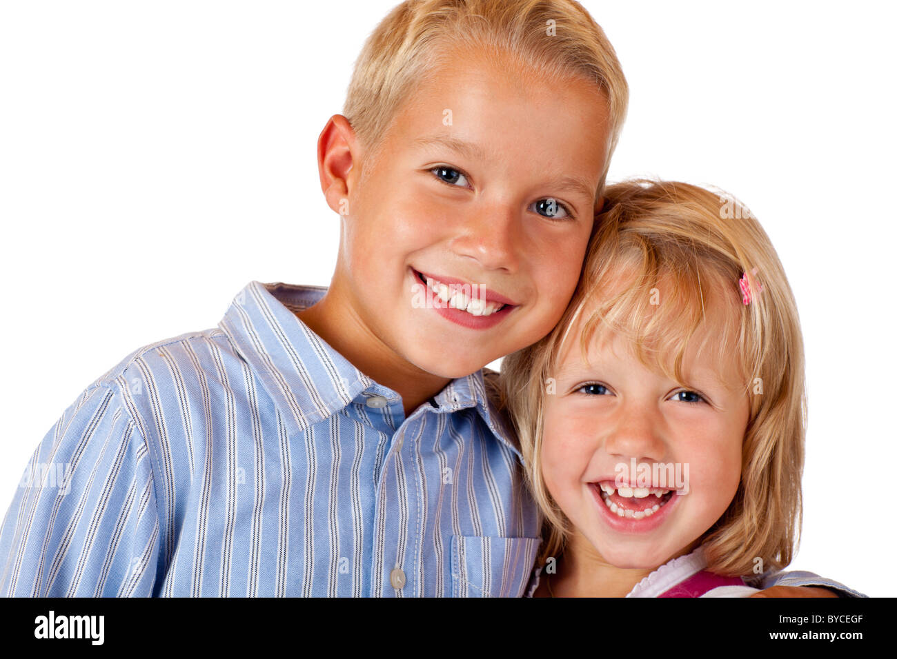 Boy and girl are smiling happy into camera. Isolated on white background. - Stock Image
