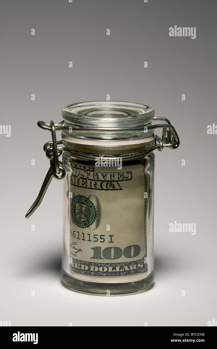 Mason Jar with a $100 bill inside. - Stock Image