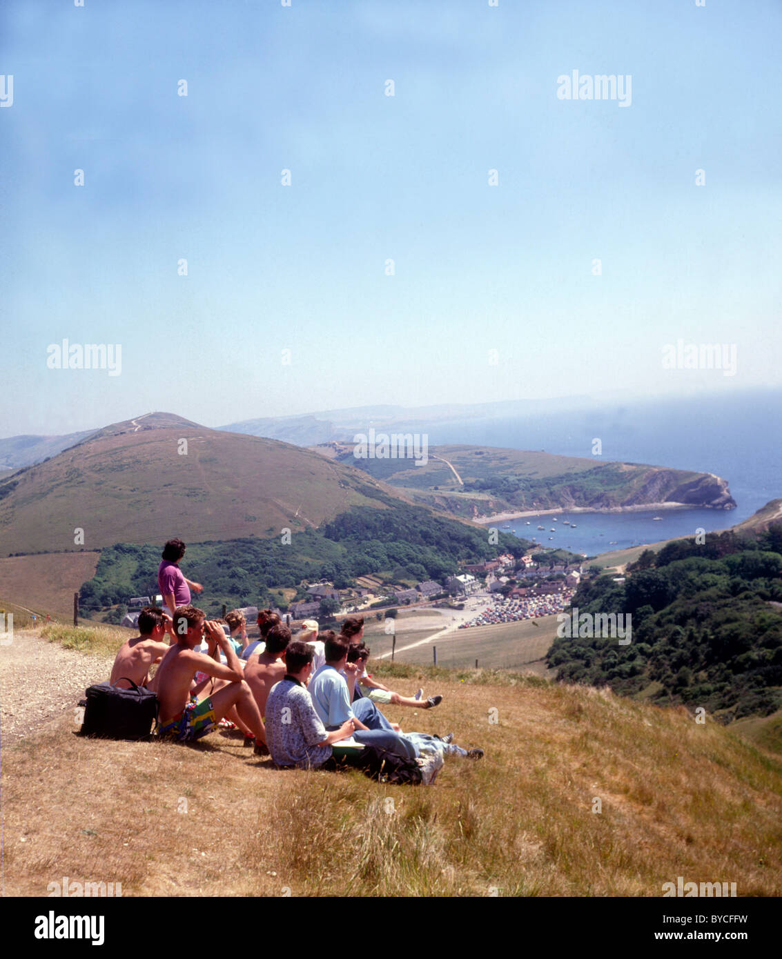 Geography fieldtrip students above Lulworth Cove Dorset - Stock Image