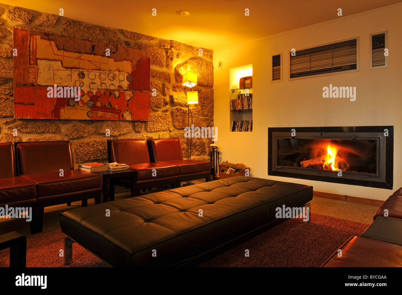 Cosy living room with panoramic fireplace - Stock Image