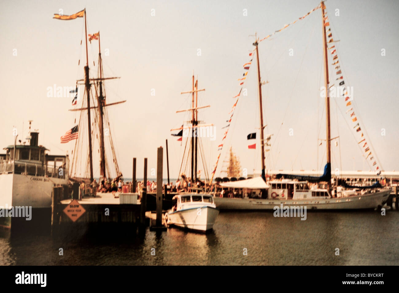 Sailing ships ready for visitors with signal flags displayed - Stock Image