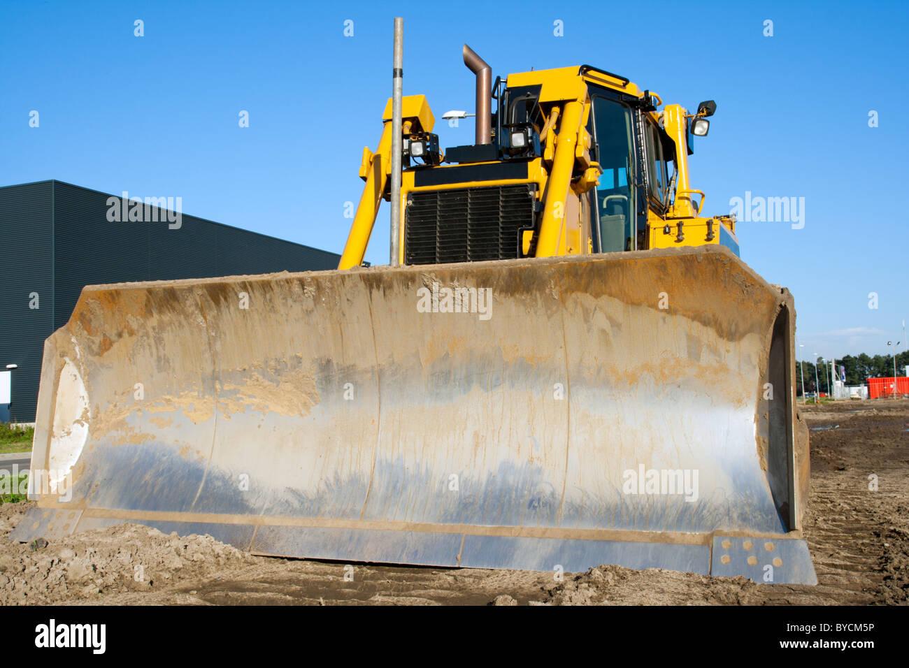 Yellow bulldozer at work - Stock Image