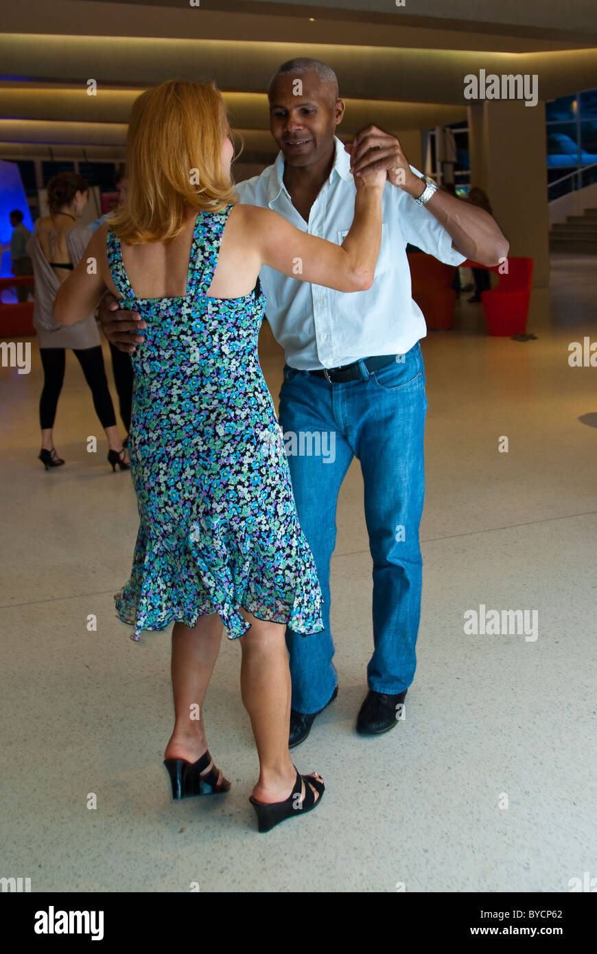 Paris, France, Mixed Race Couple Dancing Salsa at Private party ...