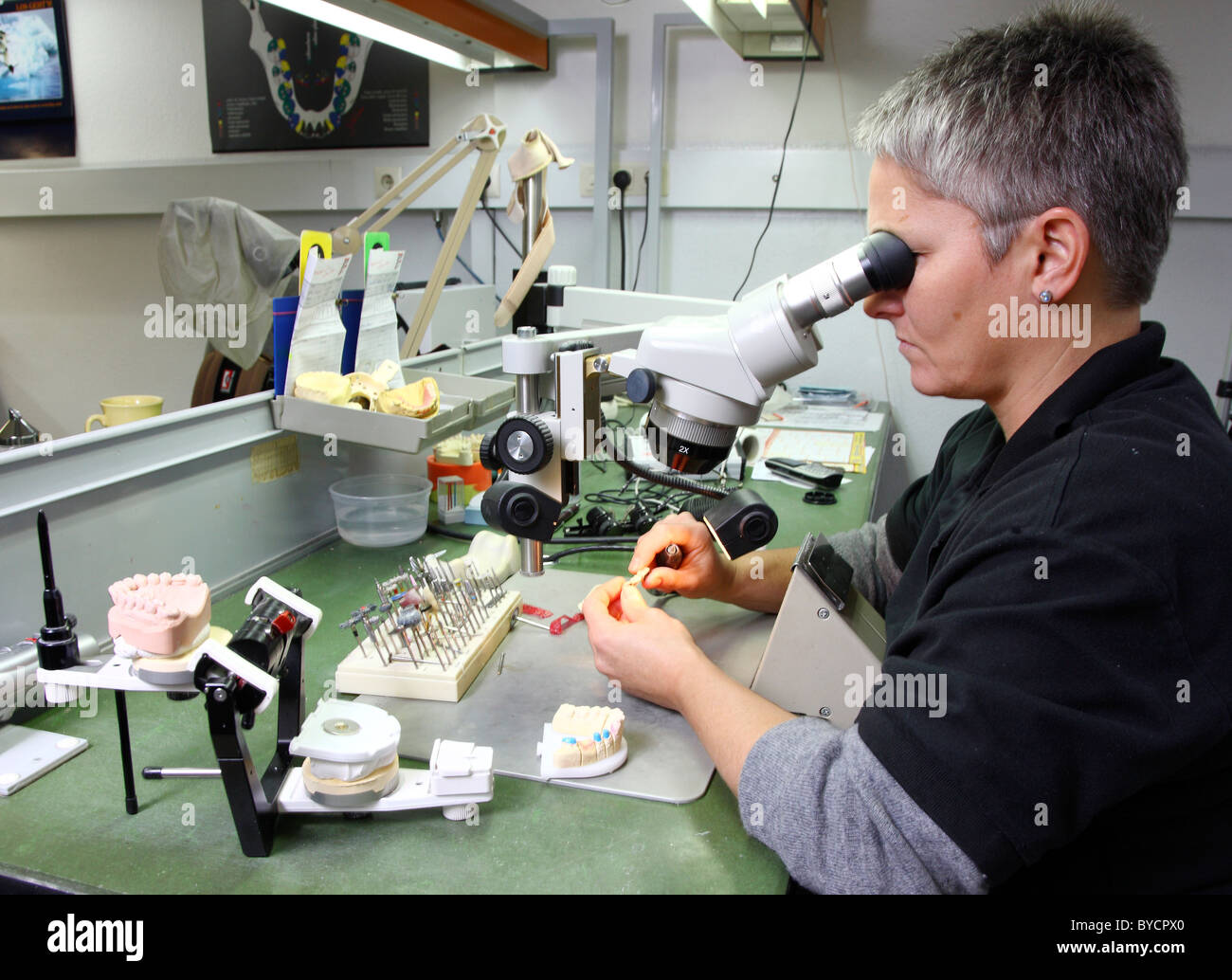 Dental laboratory, dental technician at work, making of tooth Stock Photo -  Alamy