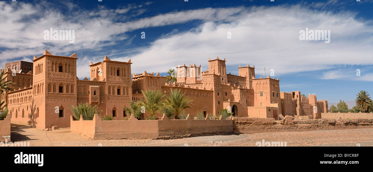 Panorama of ochre Kasbah Amerhidil on a dry river bed in the Skoura oasis Palm Grove Morocco - Stock Image