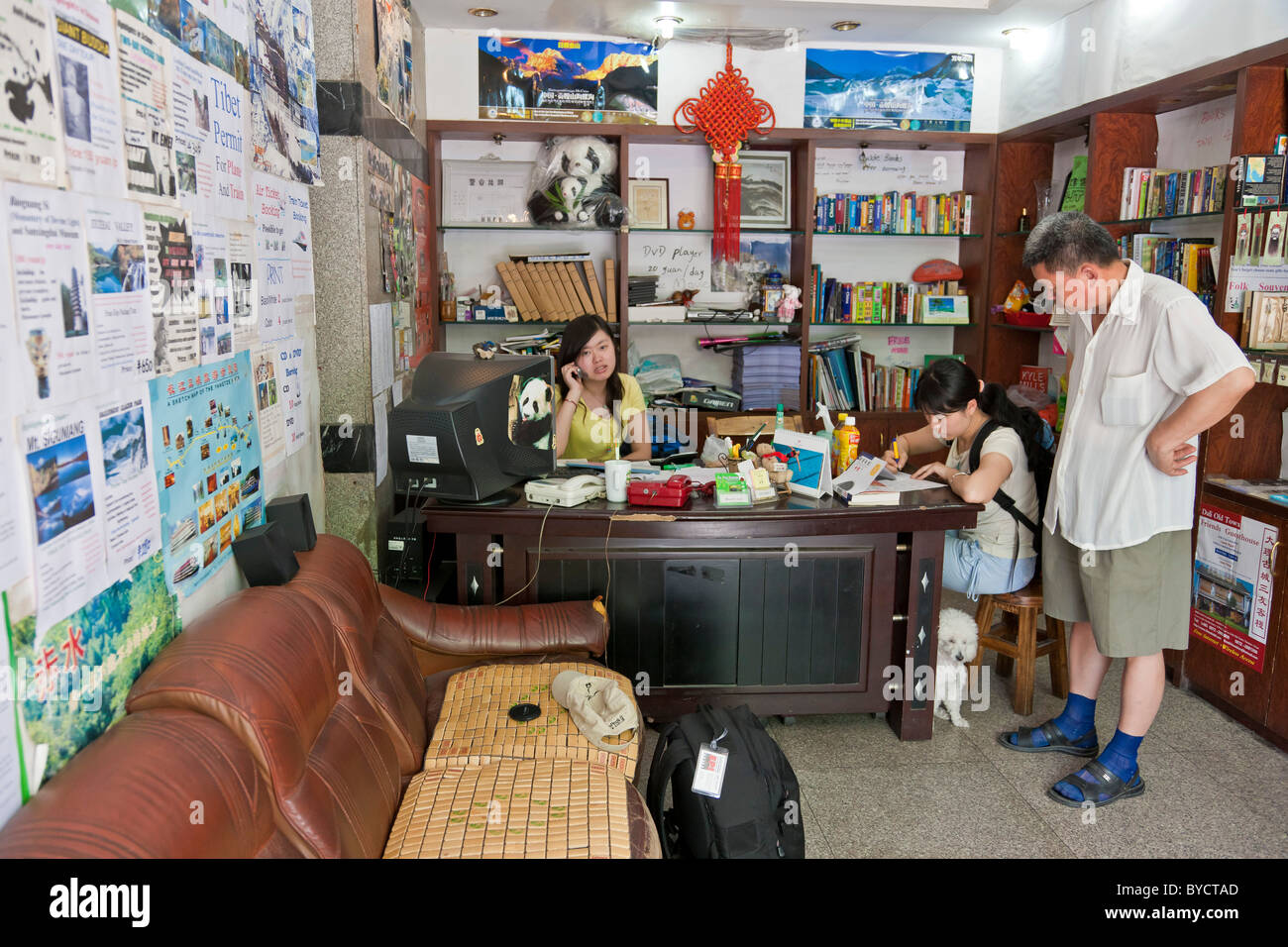 Reception of Sam's Guesthouse historic budget hostel and travel agency in Chengdu, Sichuan Province, China. - Stock Image