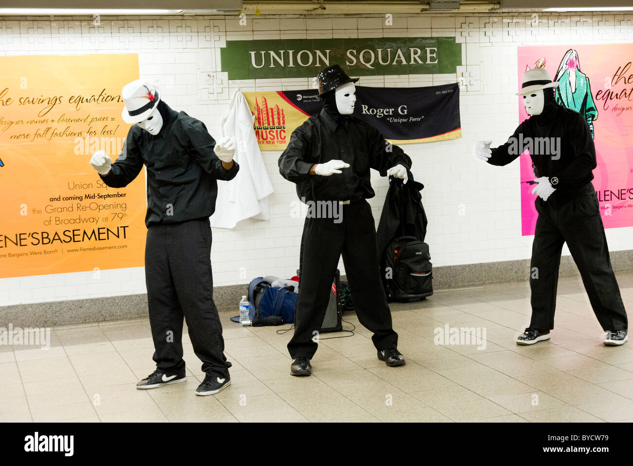 Mime artists performing at Union Square subway station, New York City, America, USA - Stock Image