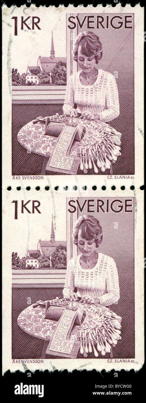 Used stamps from Sweden with drawing of a woman making lace - Stock Image