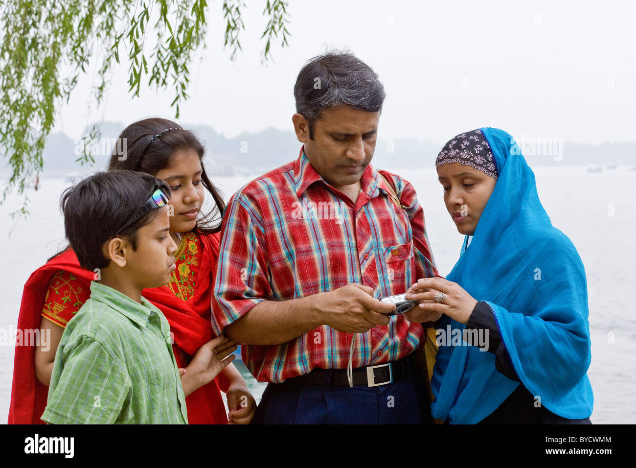 Family of tourists from Bangladesh at the New Summer Palace, Beijing, People's Republic of China. JMH4794 - Stock Image