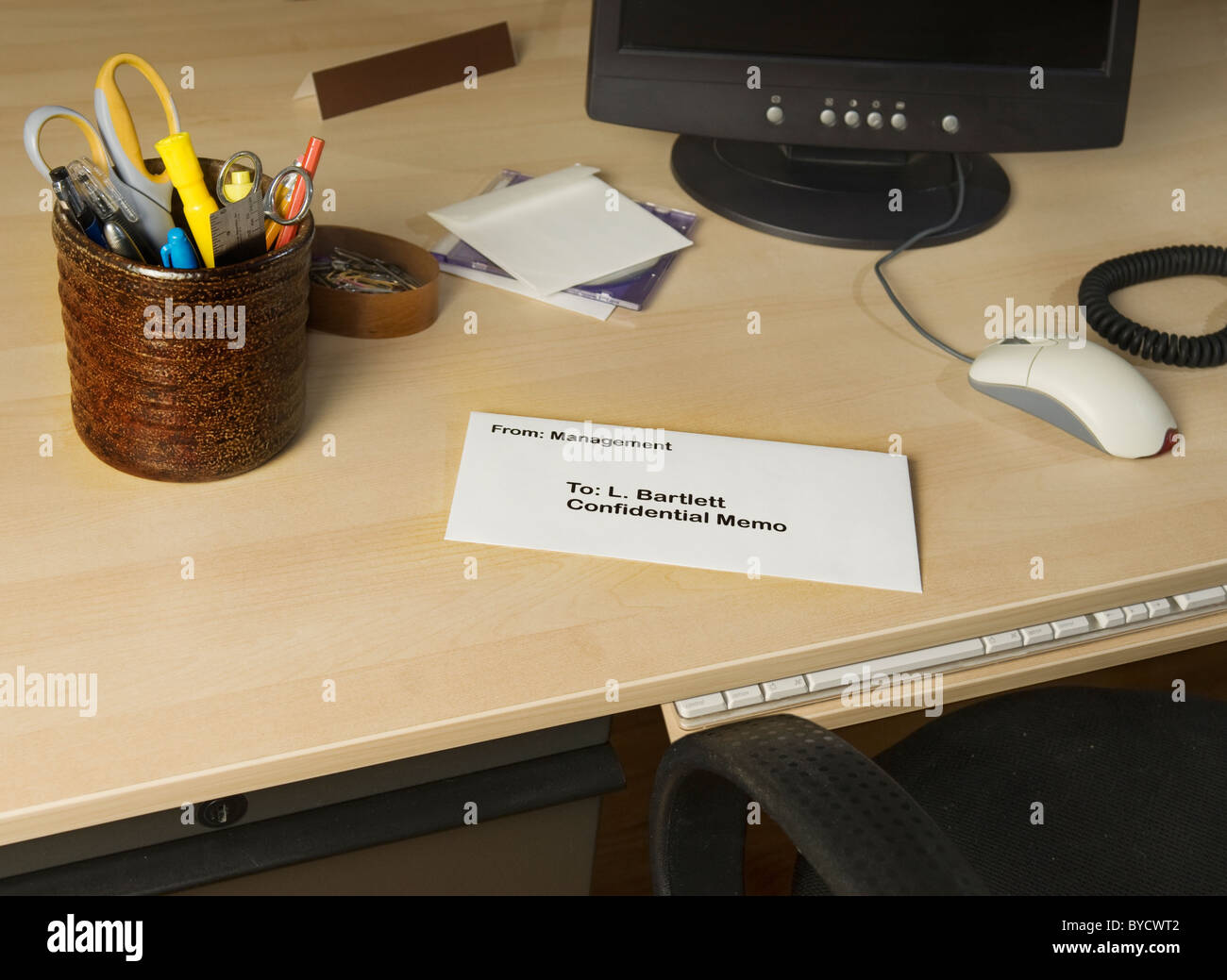 confidential memo on office desk - Stock Image