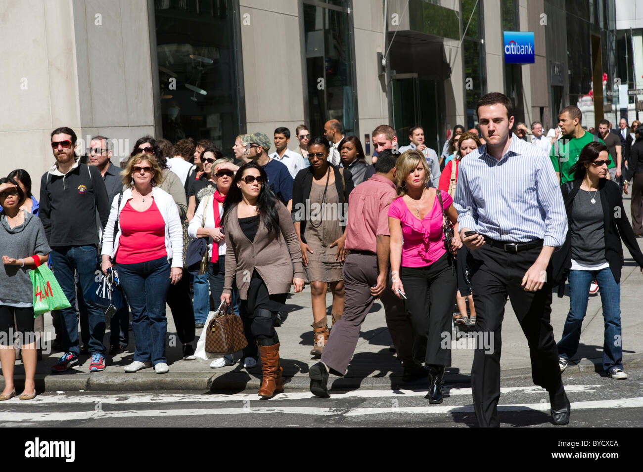 Crowd of people on Fifth Avenue, New York City, USA - Stock Image