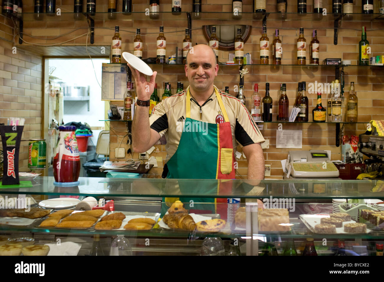 Cafe owner in Mouraria district, Lisbon, Portugal - Stock Image