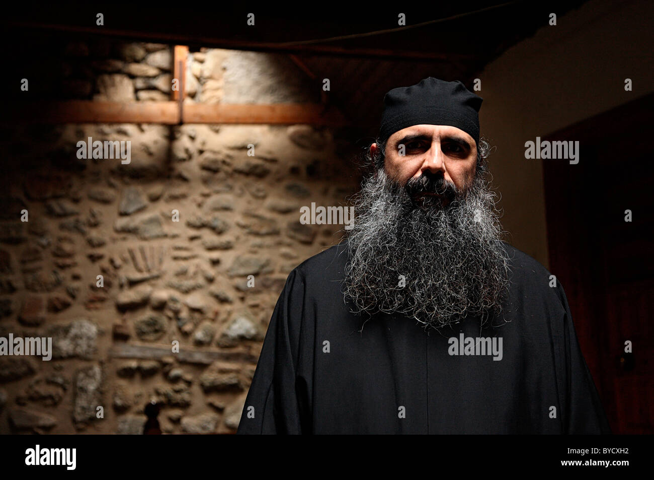 A Greek Orthodox monk in Aghia Triada ('Holy Trinity') monastery, Meteora, Greece. (Colour version) - Stock Image