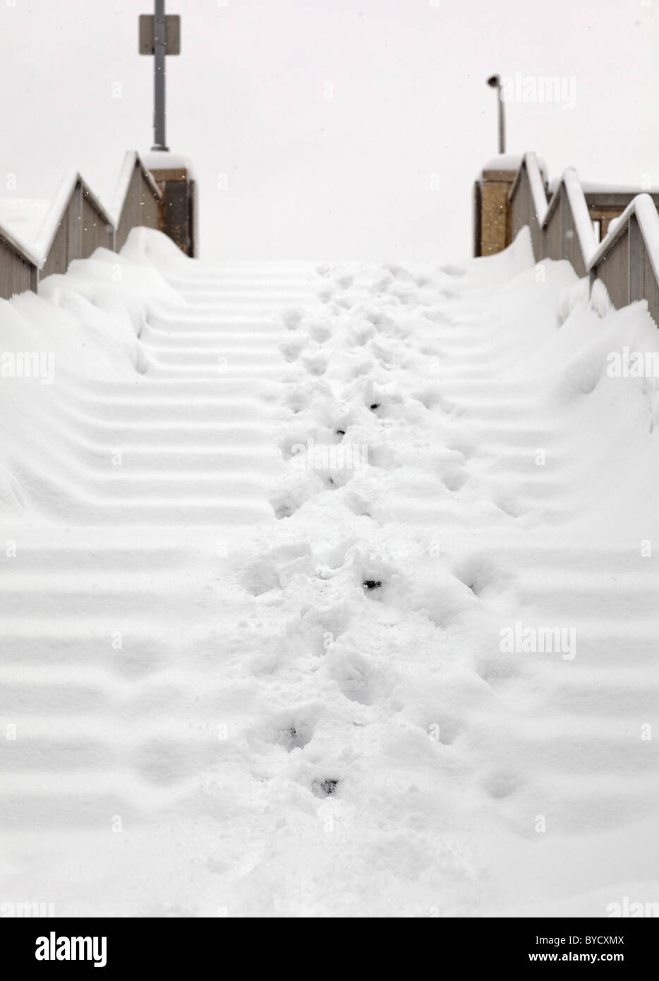 Outdoor stairs covered in snow, Winnipeg, Manitoba, Canada - Stock Image