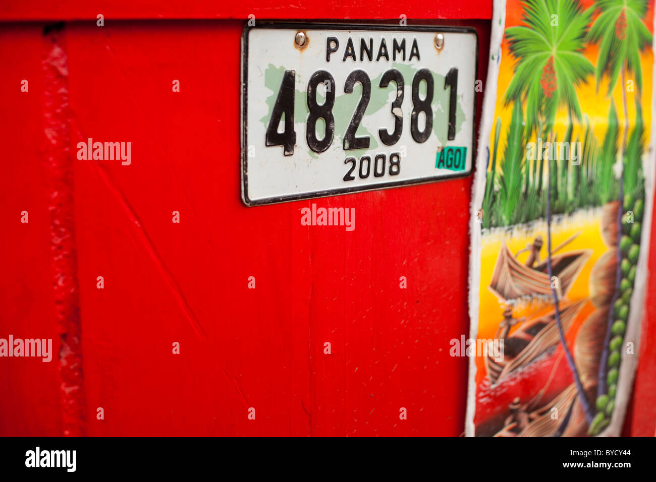 Registration Plate and painting with red in Panama - Stock Image
