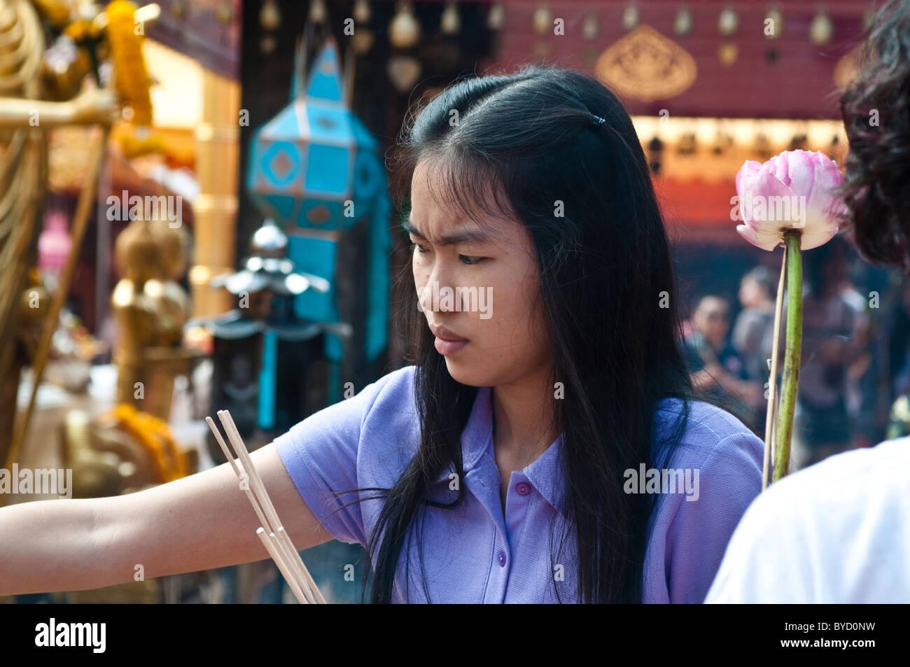 Worshiper, Wat Phra That Doi Suthep, Chiang Mai, Thailand - Stock Image