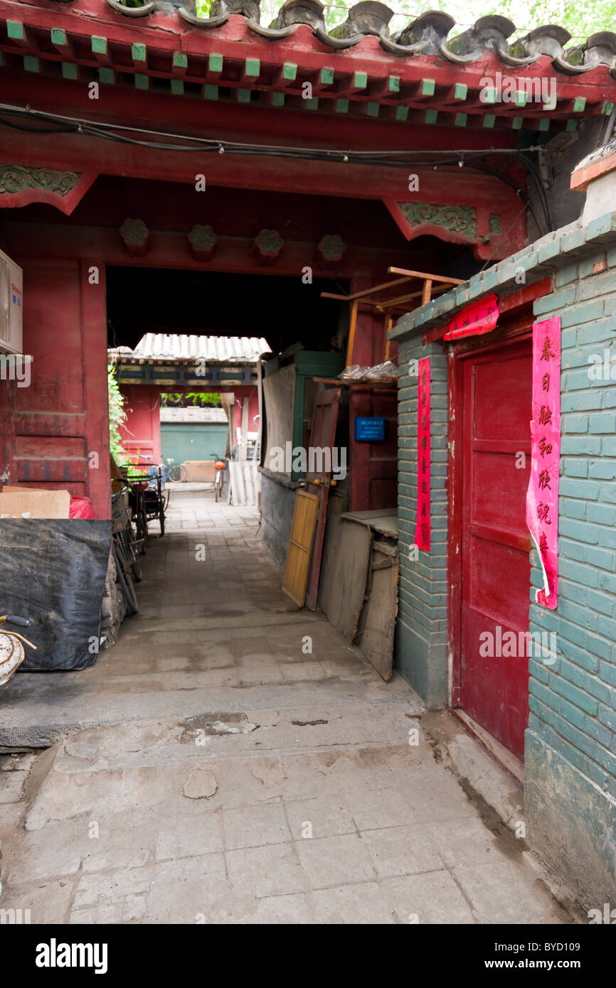 Alleyway leading to door of house in the Hutong, Beijing, China. JMH4841 - Stock Image