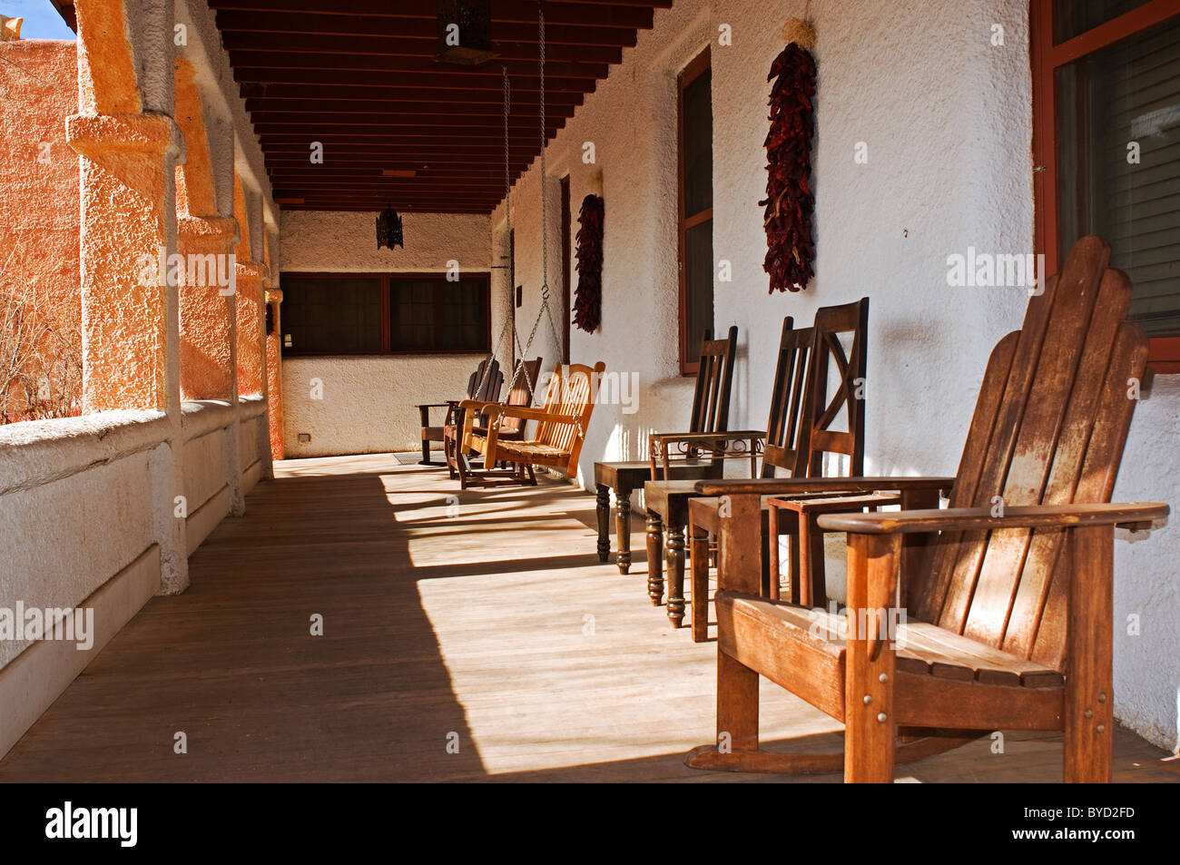 Old Fashioned Wooden Chairs On Front Porch Of Hotel Stock Photo