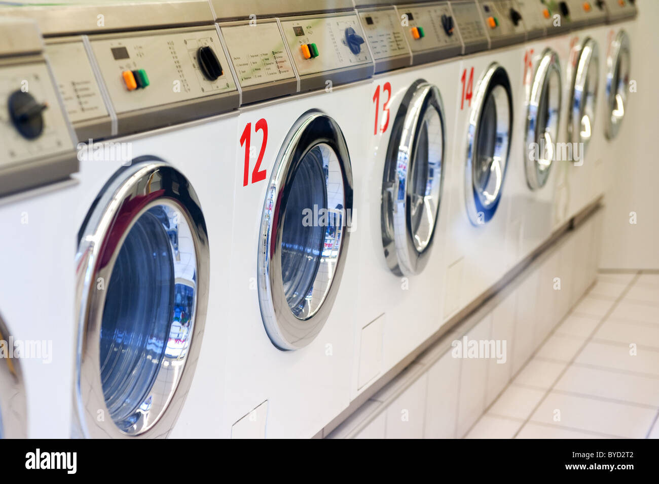 Laundromats stock photos laundromats stock images alamy many washing machines in a row for the laundry stock image solutioingenieria Images