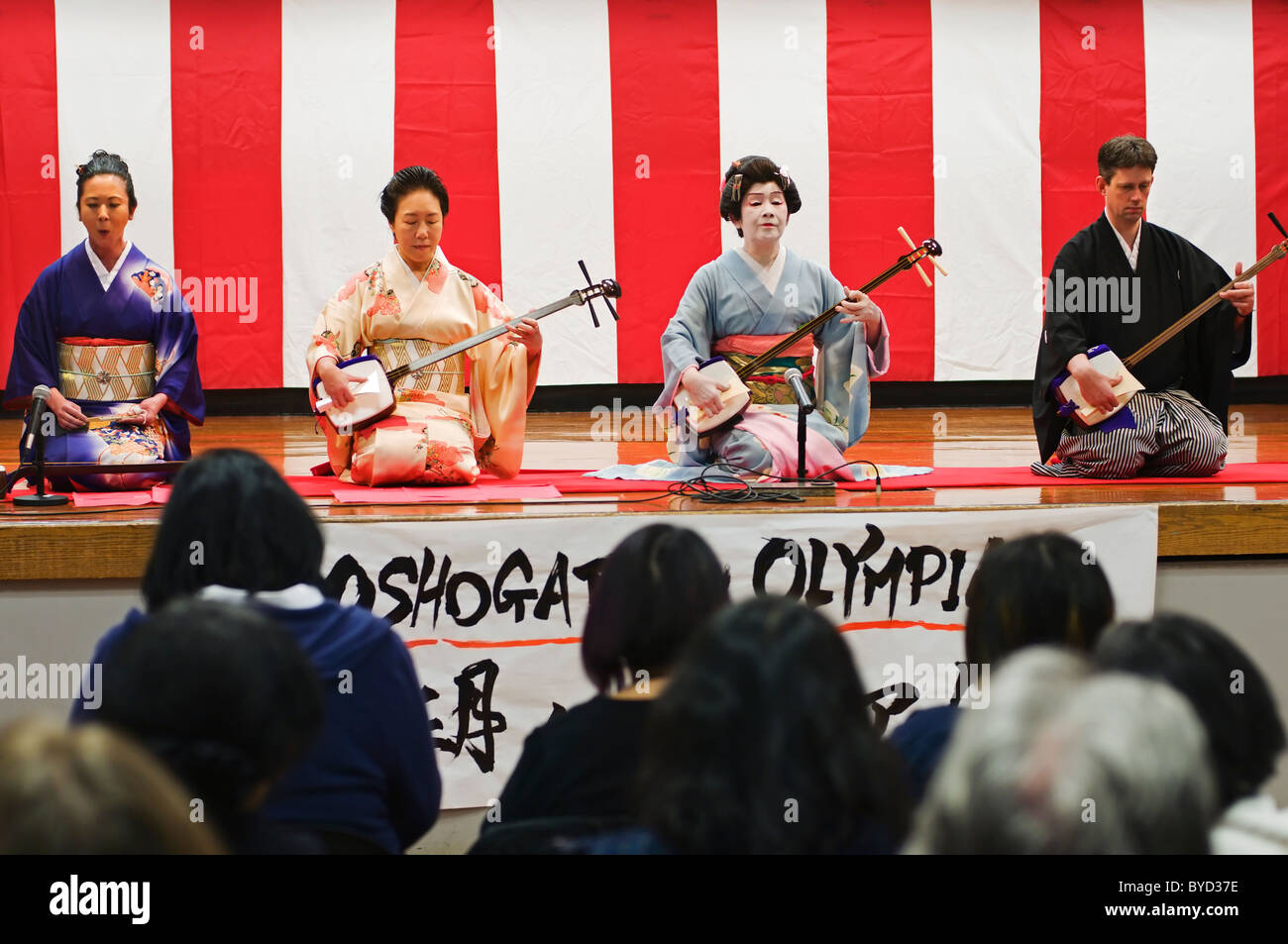 A group of musicians play the Japanese traditional three-stringed shamisen instruments during the New Year's - Stock Image