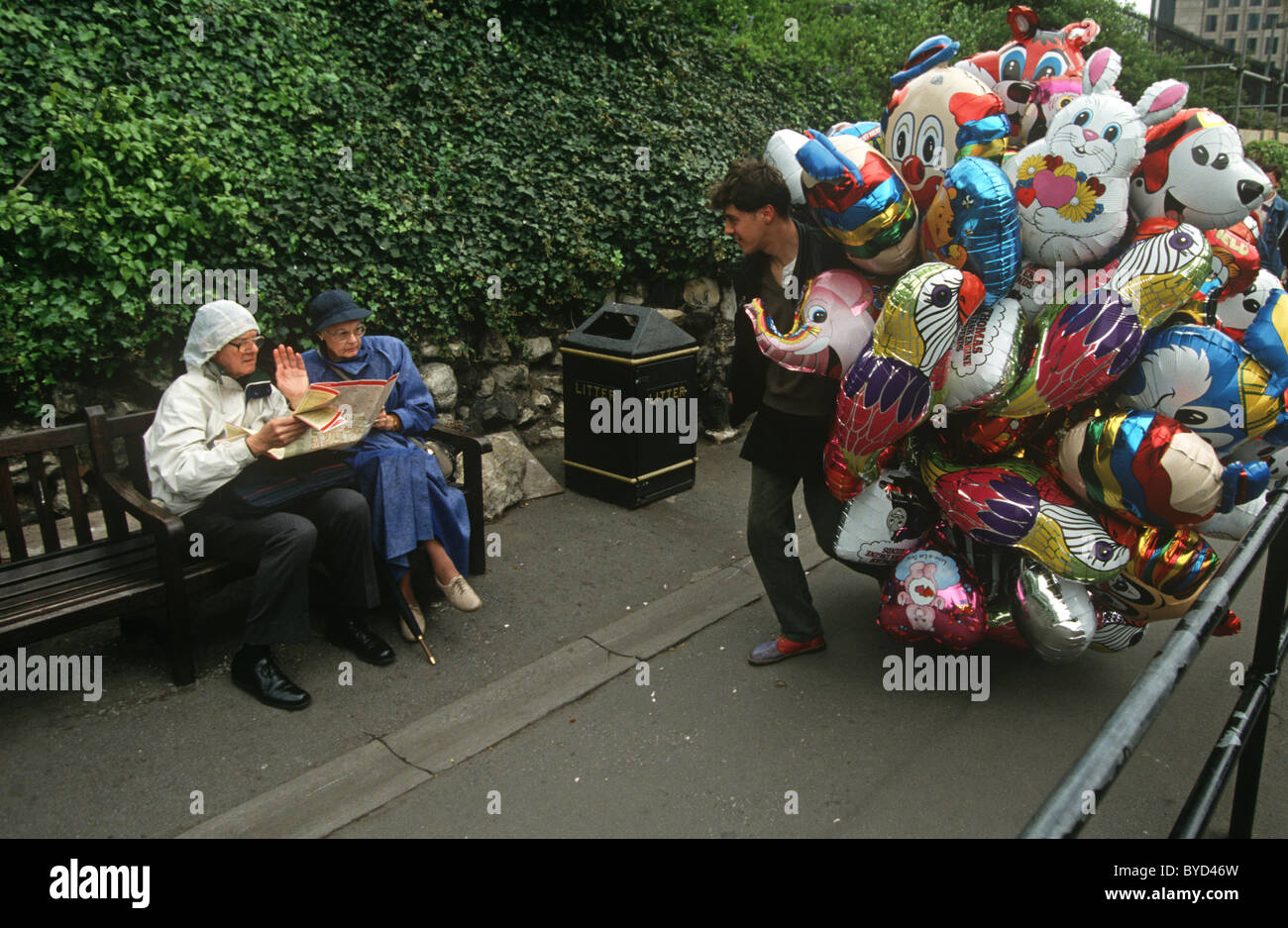 Two tourists reading a street map refuse the chance to buy a helium two tourists reading a street map refuse the chance to buy a helium balloon from a street vendor near the tower of london gumiabroncs Choice Image