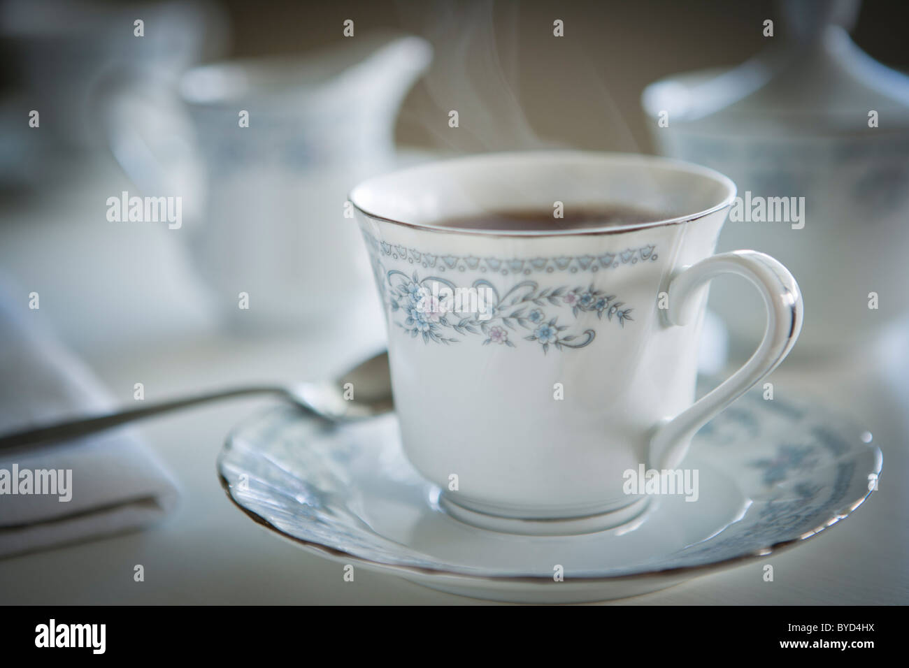 Steaming cup of tea in fine china - Stock Image