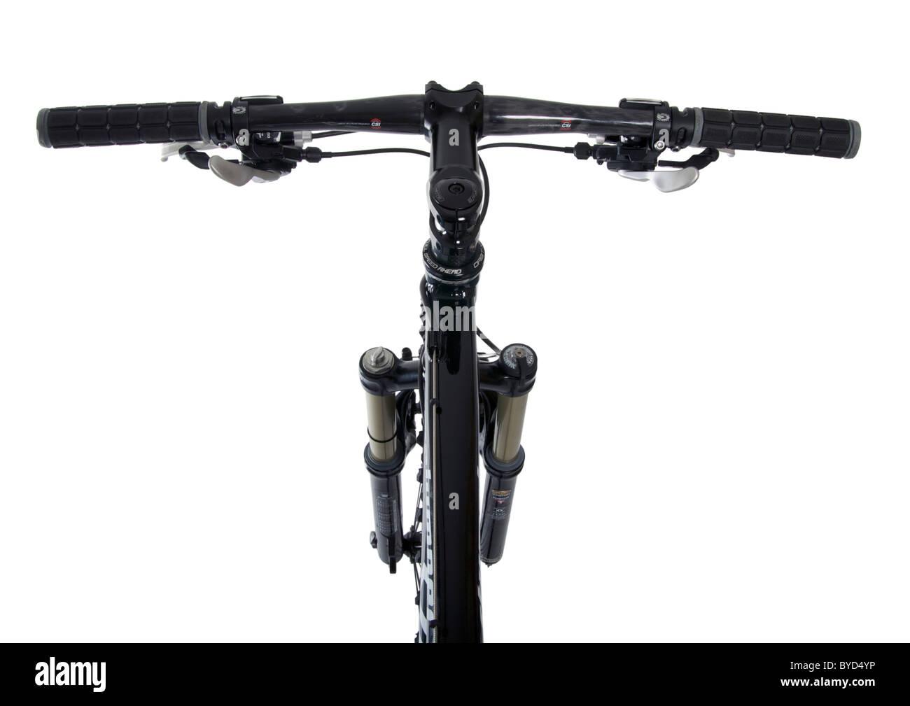Looking down on mountain bike handlebars on white background - Stock Image