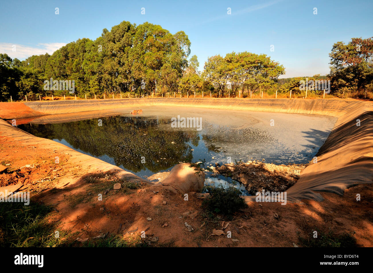 Sedimentation tanks at Lixao dump in the satellite city of Estrutural near Brasilia, Distrito Federal, Brazil, South - Stock Image