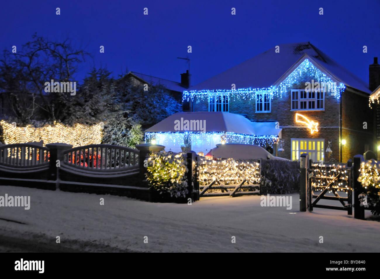 Snow house with Christmas lights - Stock Image
