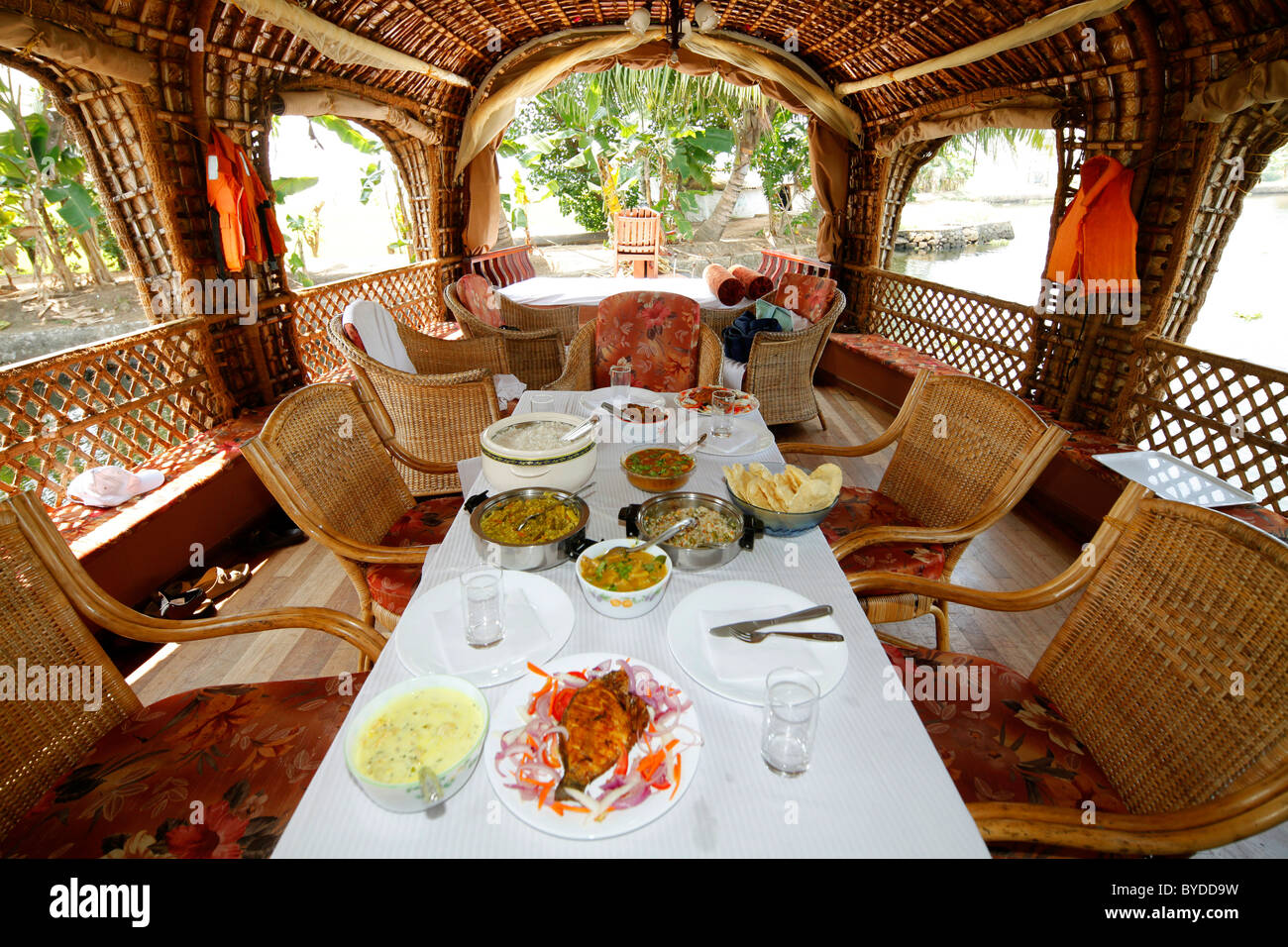 Dining table on a luxury houseboat on a canal, Haripad, Alappuzha, Alleppey, Kerala, India, Asia - Stock Image