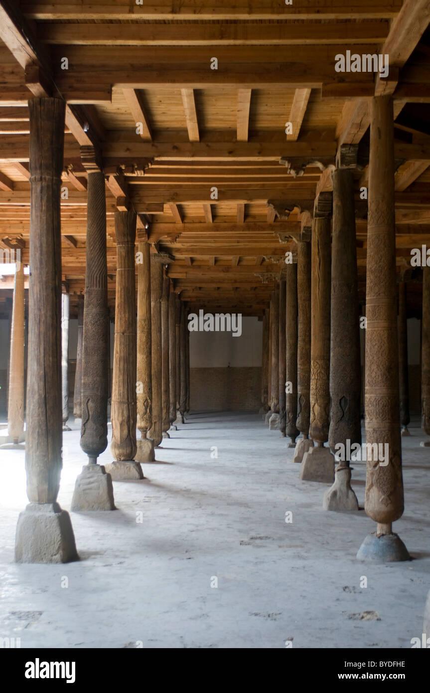 Wooden pillars in the Juma mosque, Khiva, Uzbekistan, Central Asia - Stock Image