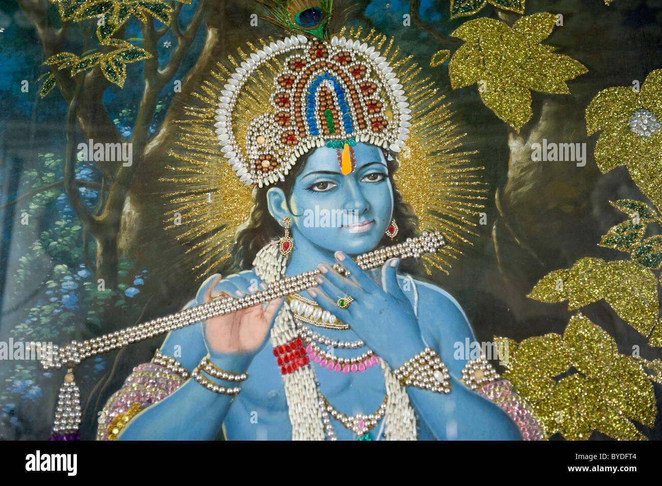 Hinduism, painting of Lord Krishna with flute, Durgiana Mandir Vishnu Temple, Amritsar, Punjab, India, South Asia - Stock Image