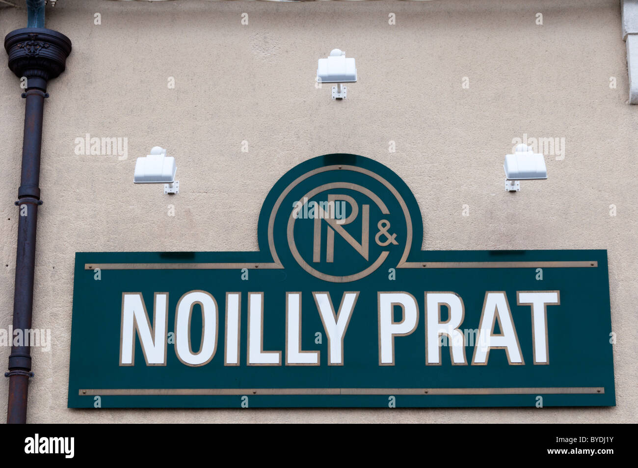 The Noilly Prat name on the side of the company's site at Marseillan in southern France. - Stock Image