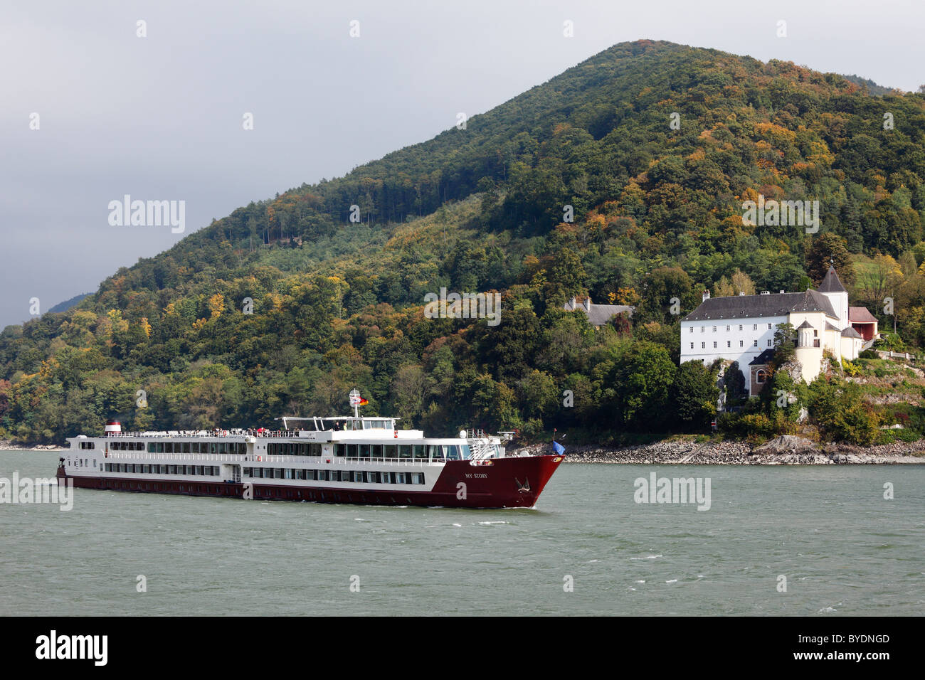 River cruise ship, My Story, in front of Servite Monastery of Schoenbuehel on the Danube, Wachau, Mostviertel, Most - Stock Image