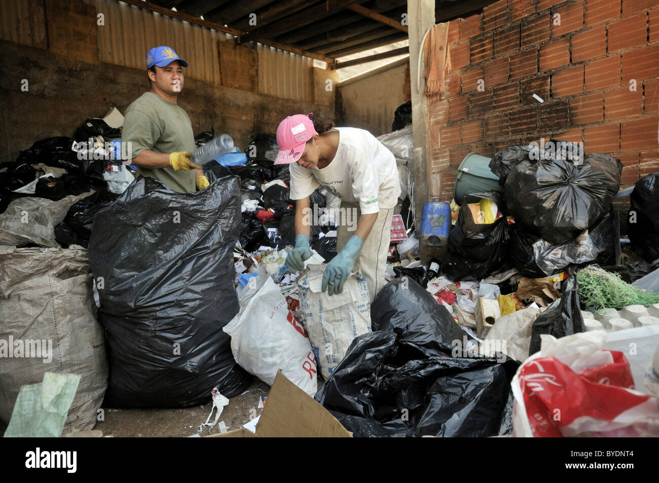 Separation of recyclables from waste in a recycling factory, social project for ex-prisoners 'Reintegar Reciclando' - Stock Image