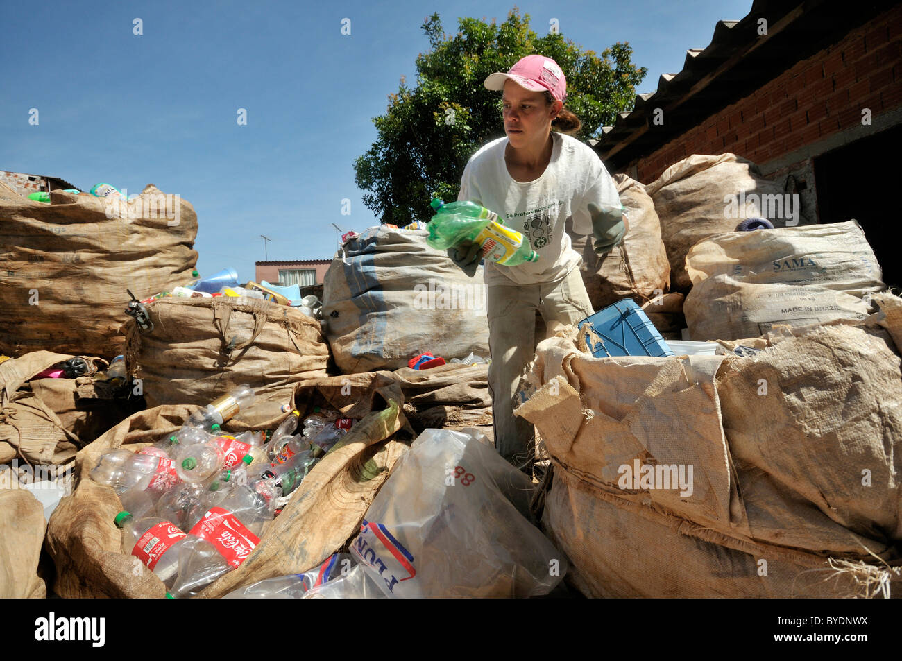 Separation of recyclables from waste in a recycling factory, plastic bottles, social project for ex-prisoners 'Reintegar - Stock Image