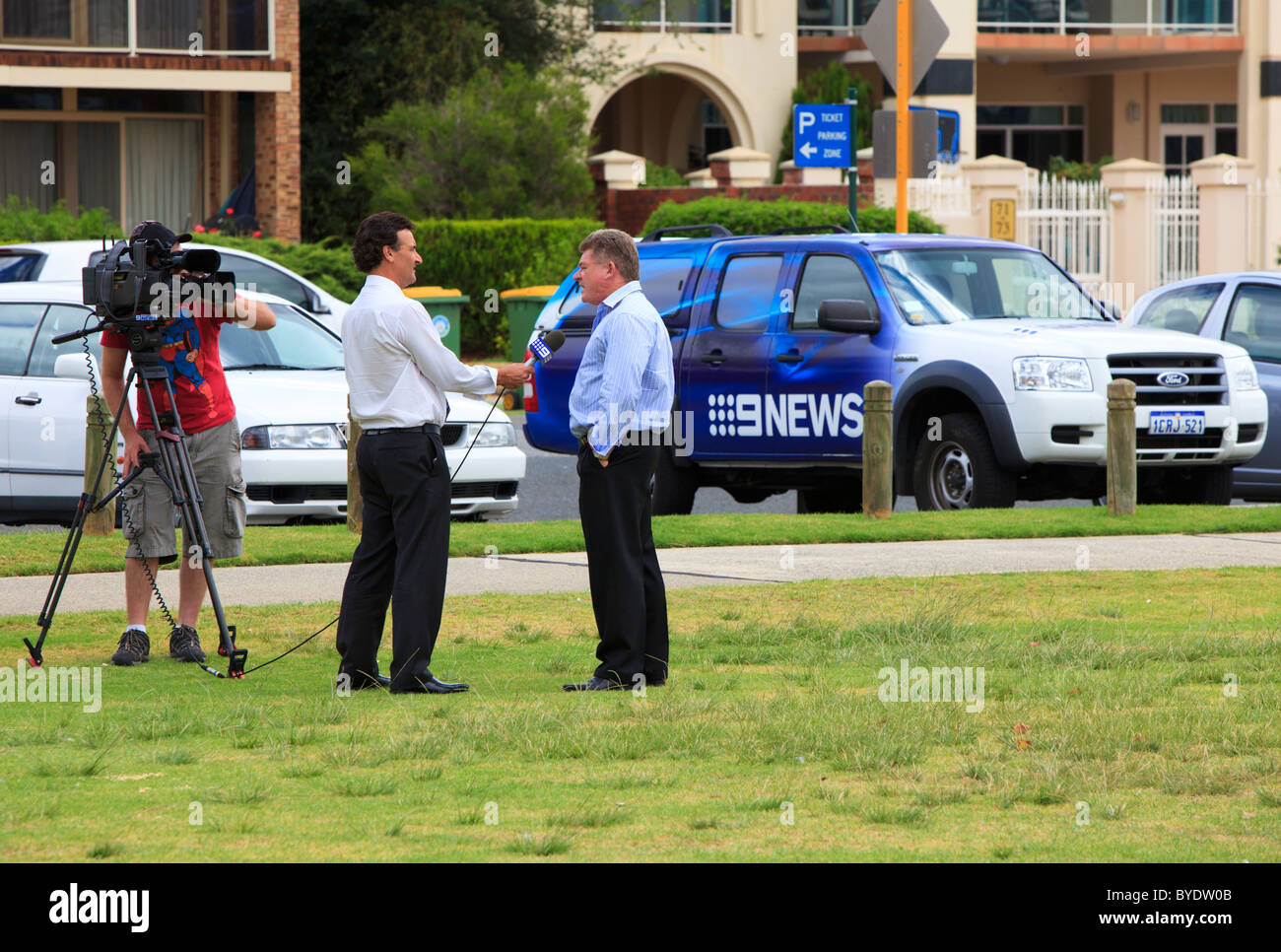 Channel 9 News interview being filmed with the 9News car in the