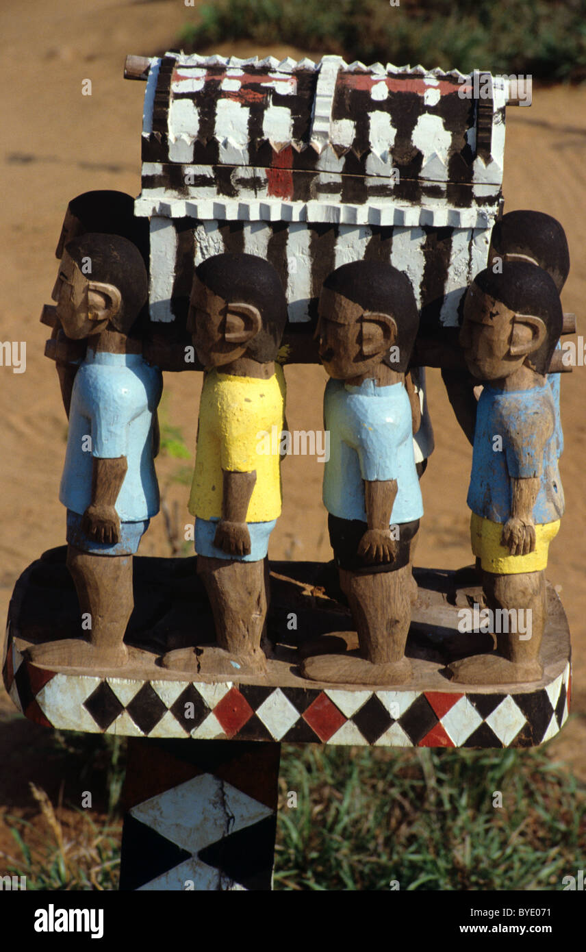 Mahafaly Painted Funerary Sculpture, Tomb Art, Totem, Stele or Aloalo, Men Carrying Coffin, near Tulear, Madagascar - Stock Image