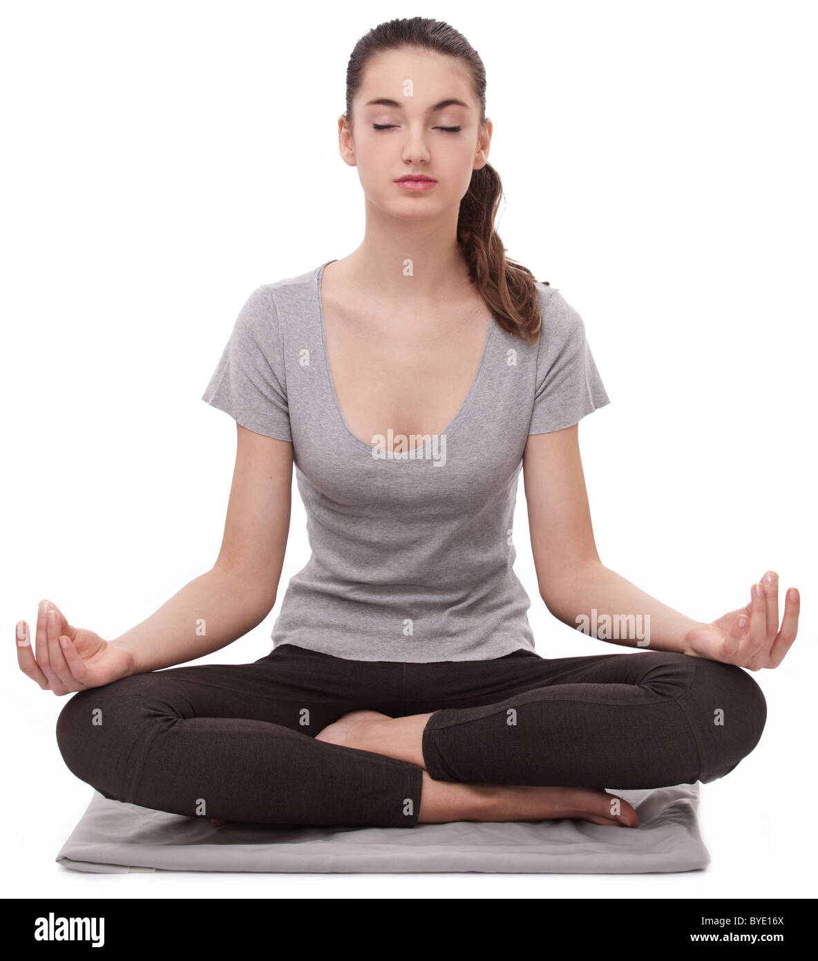 Girl practicing yoga. Isolated in a white background. - Stock Image
