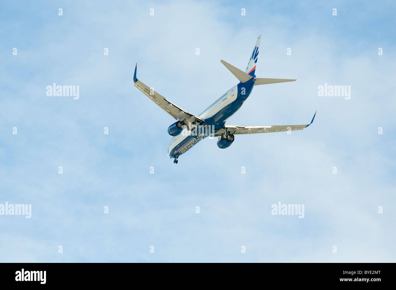 low flying commercial airliner plane planes airplane airplanes airport landing approaching landing take off taking - Stock Image