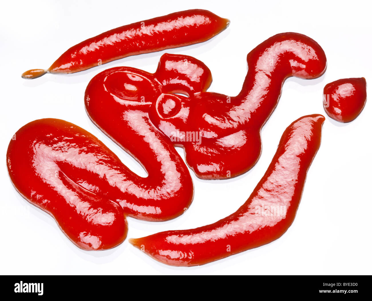 Portion of ketchup isolated on a white background. - Stock Image