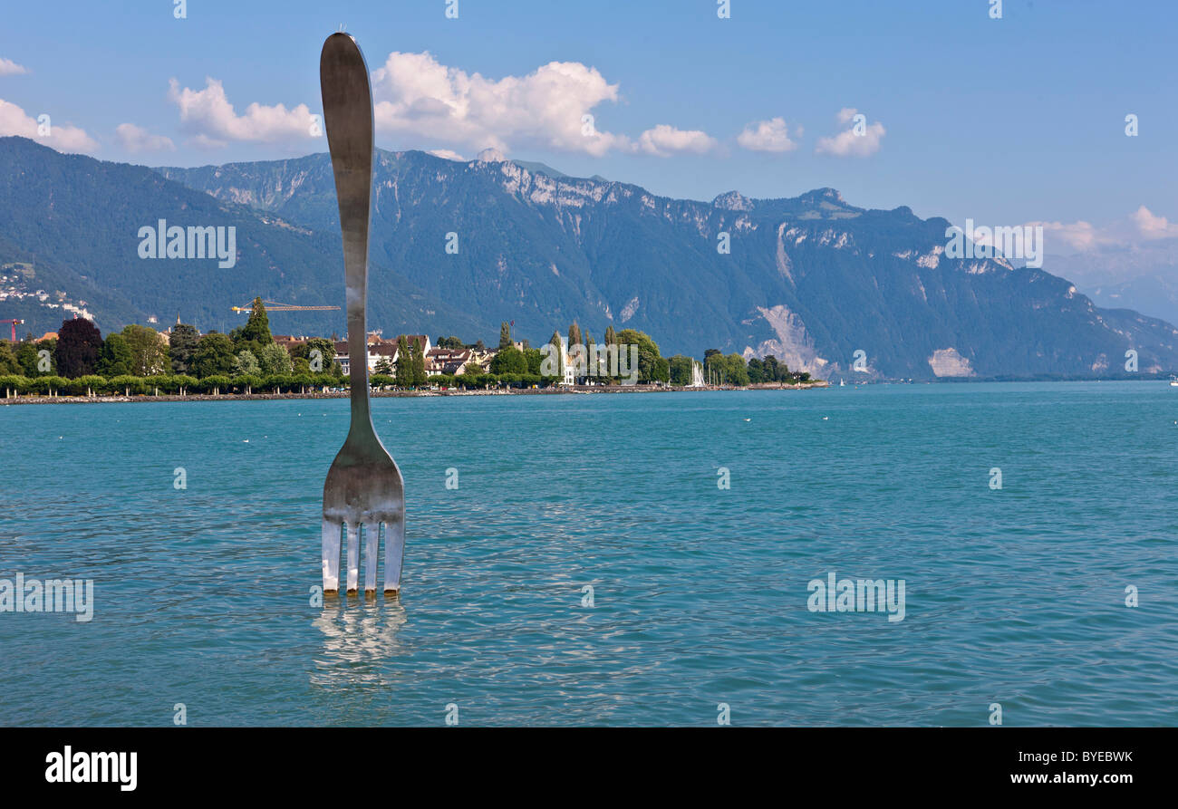 La Fourchette, the fork, sculpture created by Jean-Pierre Zaugg, located in front of the Alimentarium Museum, Vevey, - Stock Image