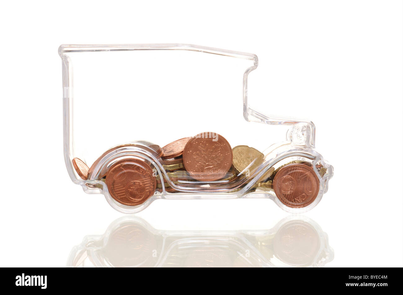 Transparent truck with Euro coins, symbolic image for transparent transport costs - Stock Image