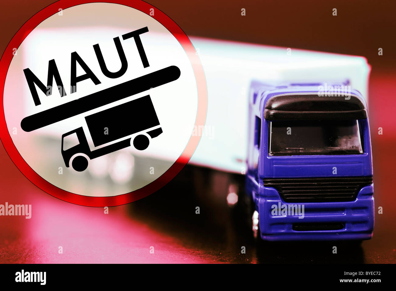 Miniature truck and a road toll sign, symbolic image for trucks paying road toll - Stock Image