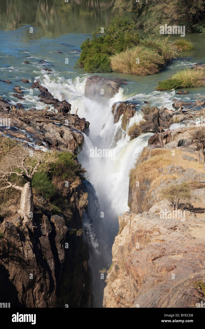 At the beautiful Epupa Falls the Kunene River drops in a series of cascades into a 60 m deep gorge, Namibia - Stock Image