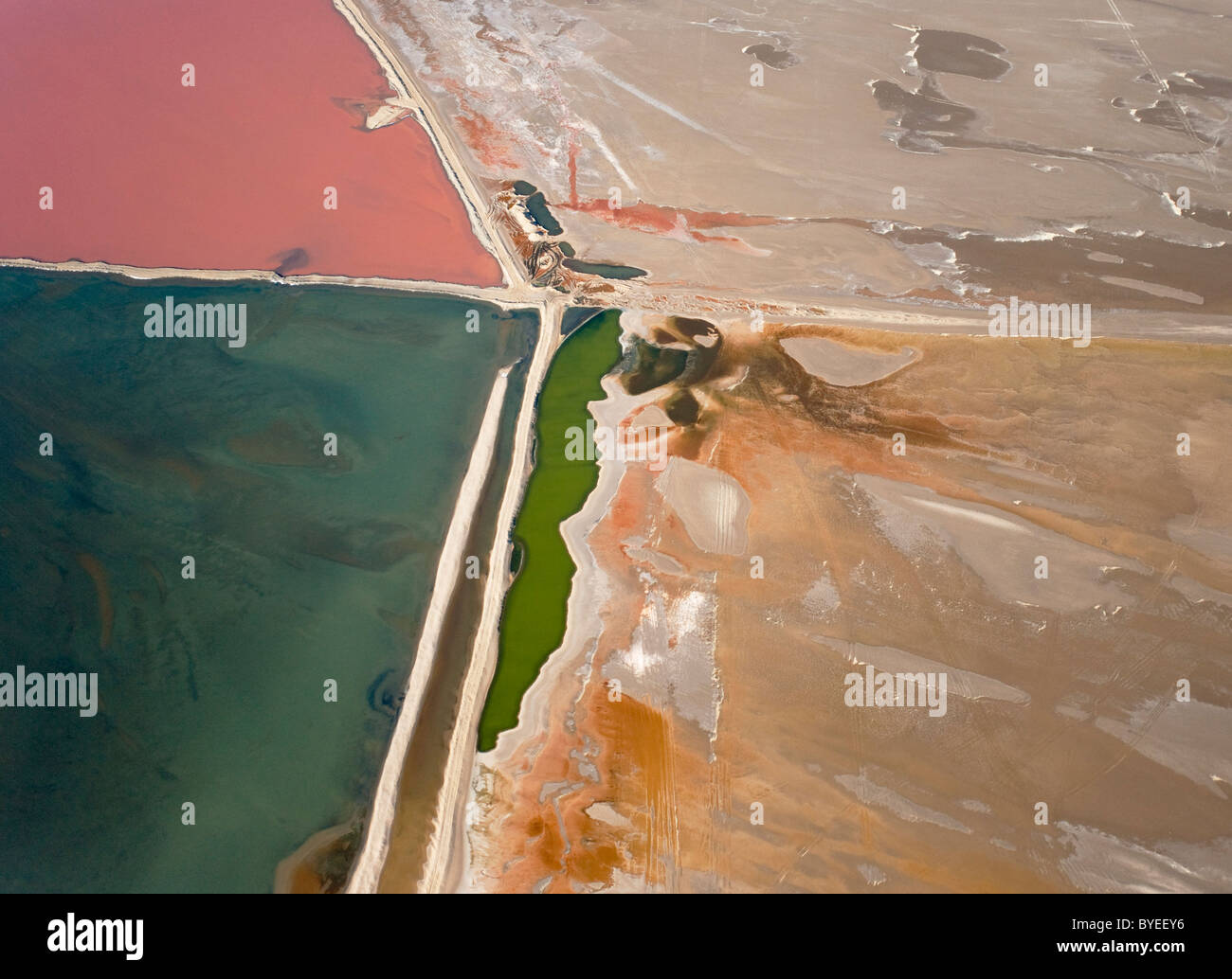 Aerial view of saline water at the salt works of Walvis Bay between Namib Desert and Atlantic Ocean. - Stock Image